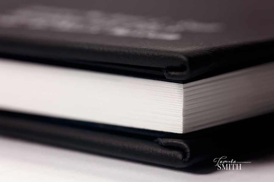 Closer look at professional black leather album by National Archives Promotion Photographer