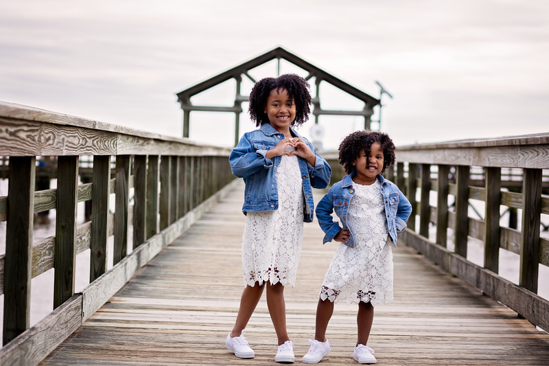 Two sisters posing on boardwalk in Leesylvania State Park in Woodbridge, VA