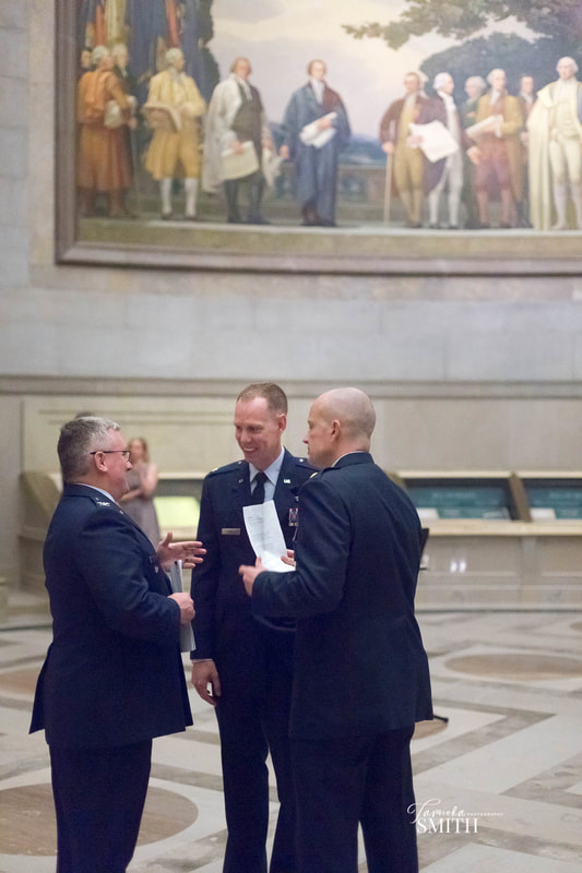 Air Force Officers talking inside the National Archives Museum