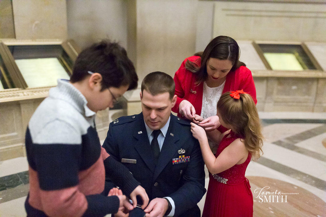 Pinning on Major Rank at Promotion Ceremony at The National Archives Museum