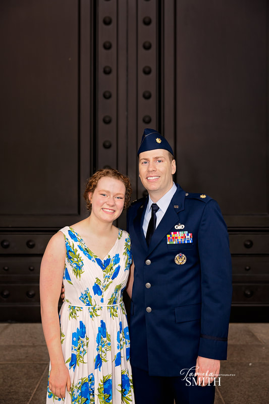 Air Force officer with his sister after a promotionj ceremony at The National Archives Museum
